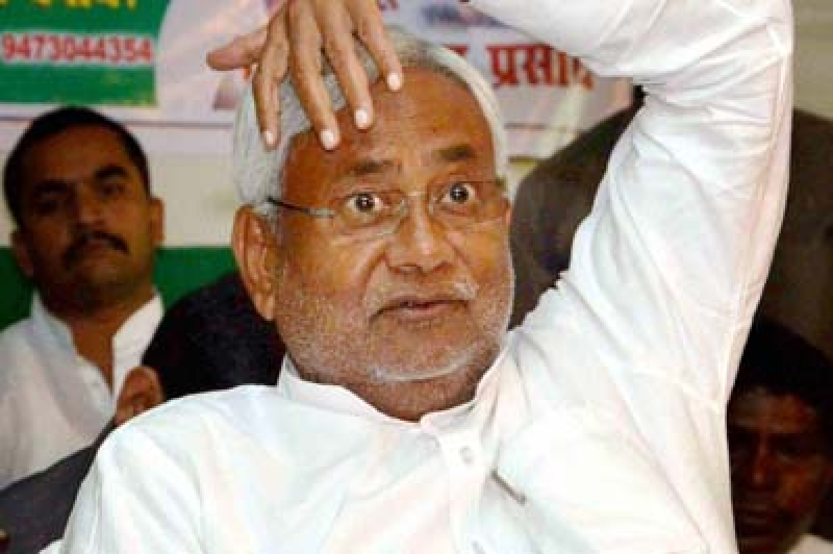 oops… nitish Kumar caught consulting a tantrik