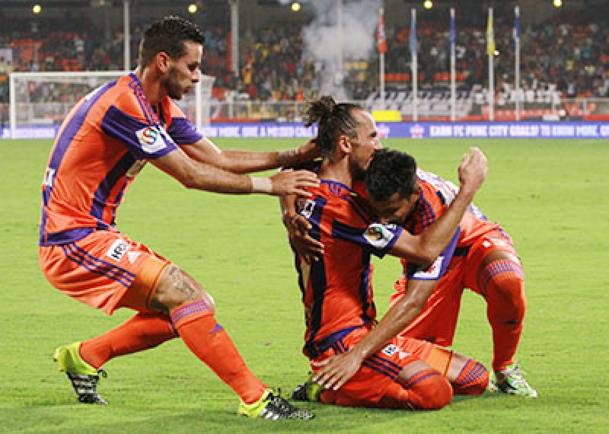 FC Pune City players celebrates a goal during match 3 of the Indian Super League (ISL) season 2  between FC Pune City and Mumbai City FC held at the Shree Shiv Chhatrapati Sports Complex Stadium, Pune, India on the 5th October 2015.  Photo by Vipin Pawar / ISL/ SPORTZPICS