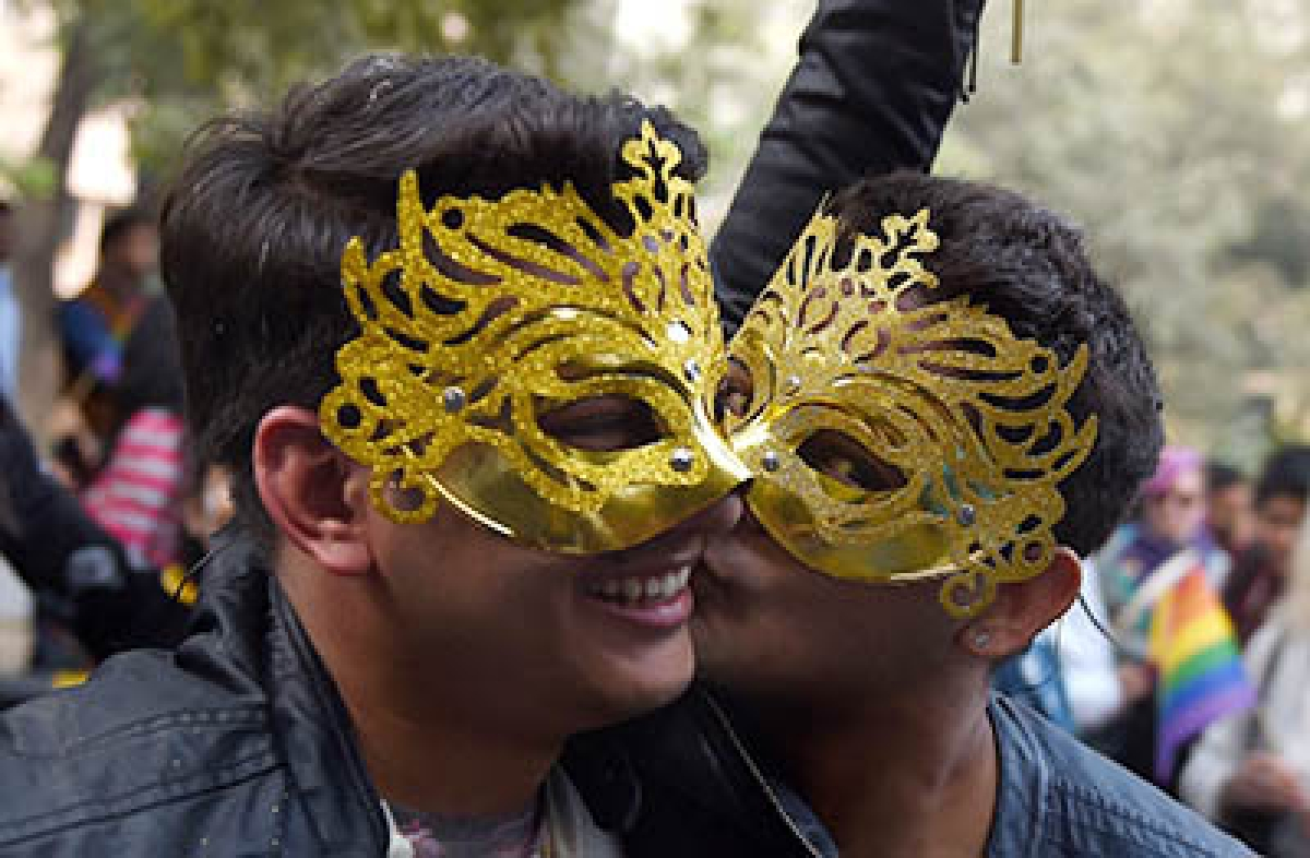 Indian members and supporters of the lesbian, gay, bisexual, transgender (LGBT) community attend the eighth Delhi Queer Pride parade in New Delhi on November 29, 2015. Marching in solidarity and in celebration of their diversity, the LGBT community demanded equal legal, social and medical rights.   AFP PHOTO / Money SHARMA