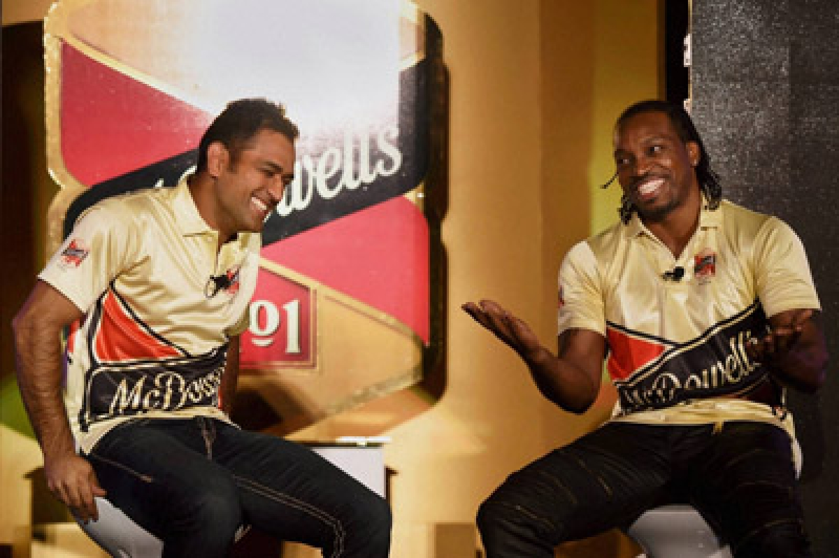 New Delhi: Indian Skipper M S Dhoni and West Indies cricketer Chris Gayle at a promotional event of Mcdowell's No.1 Soda in New Delhi on Monday. PTI Photo by Manvender Vashist   (PTI11_2_2015_000105B)