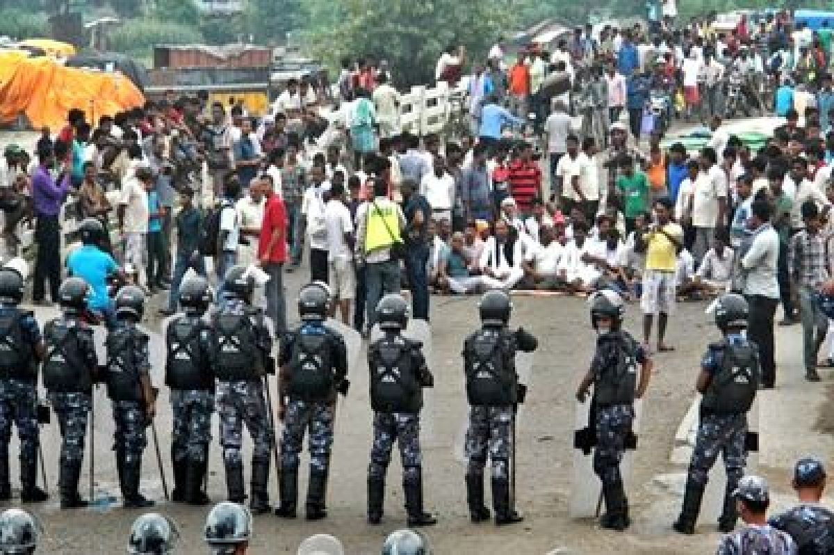 Nepal police clear protesters from key trade point with India