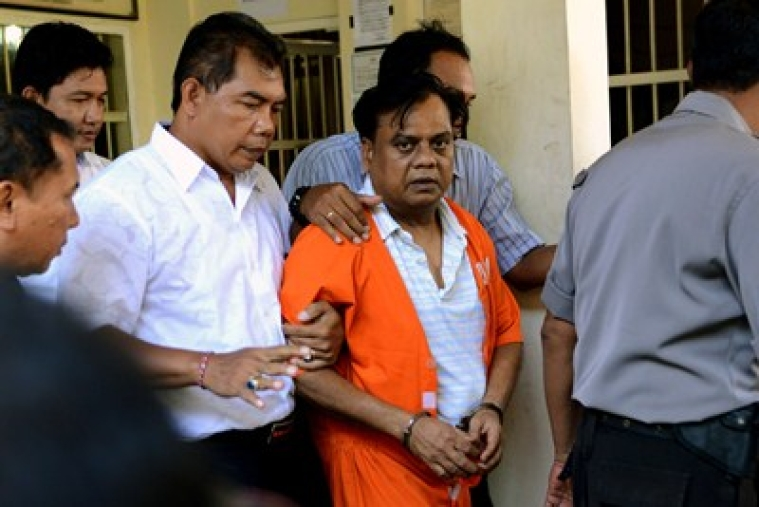 Indian national Rajendra Sadashiv Nikalje, 55, known in India as Chhota Rajan, is brought out from a holding cell at the Bali police headquarters in Denpasar on Bali island on November 2, 2015. An alleged Indian crime boss wanted in his home country for up to 20 murders has been arrested in Indonesia after two decades on the run, police said October 26. Nikalje had been evading police in several countries for years, with Interpol flagging him as a wanted man back in 1995. AFP PHOTO / SONNY TUMBELAKA