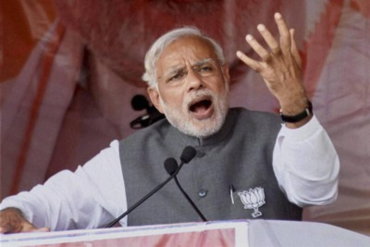Muzaffarpur: Prime Minister Narendra Modi addresses an election rally, in Muzaffarpur on Friday. PTI Photo(PTI10_30_2015_000107B)