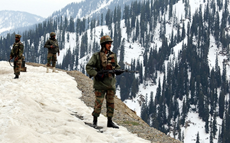 Indian army soldiers stand guard near to where an encounter took of Kashmir's Kupwara district