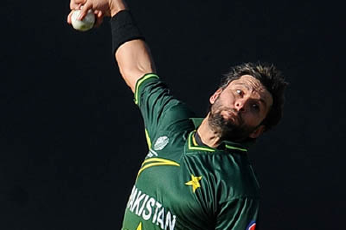 Pakistan's cricket team captain Shahid Afridi delivers a ball during the Group A match in the Cricket World Cup tournament between Pakistan and New Zealand at The Pallekele International Cricket Stadium in Pallekele on March 8, 2011.  New Zealand are 108 runs for the loss of two wickets in 27 overs after captain Daniel Vettori won the toss and elected to bat. AFP PHOTO/Lakruwan WANNIARACHCHI (Photo credit should read LAKRUWAN WANNIARACHCHI/AFP/Getty Images)
