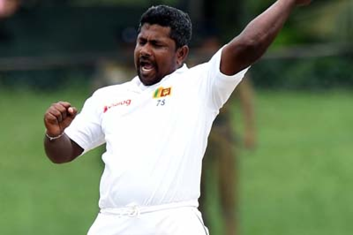 Sri Lankan cricketer Rangana Herath celebrates after dismissing West Indies cricketer Kemar Roach during the final day of their second Test cricket match between Sri Lanka and the West Indies at The P. Sara Oval Cricket Stadium in Colombo on October 26, 2015.
