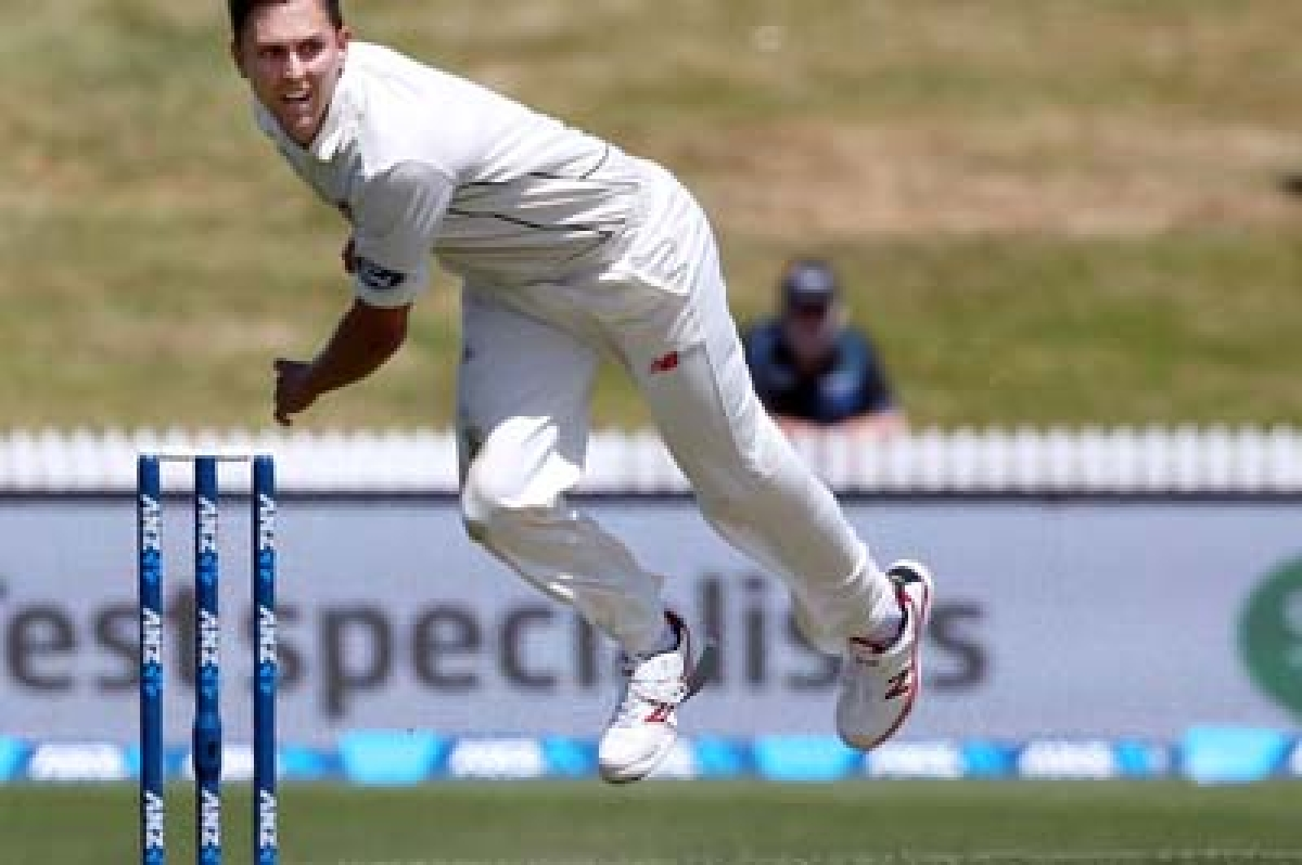 Trent Boult of New Zealand bowls during day one of the International Test cricket match between New Zealand and Sri Lanka at Seddon Park in Hamilton on December 18, 2015. AFP PHOTO / Michael Bradley