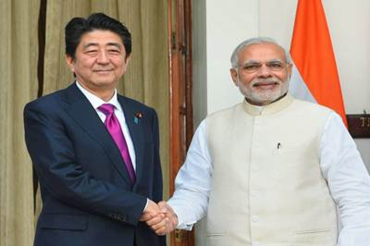 New Delhi:  Prime Minister Narendra Modi shakes hands with  his Japanese counterpart Shinzo Abe before their meeting, in New Delhi on Saturday. PTI Photo by Shahbaz Khan(PTI12_12_2015_000007B)