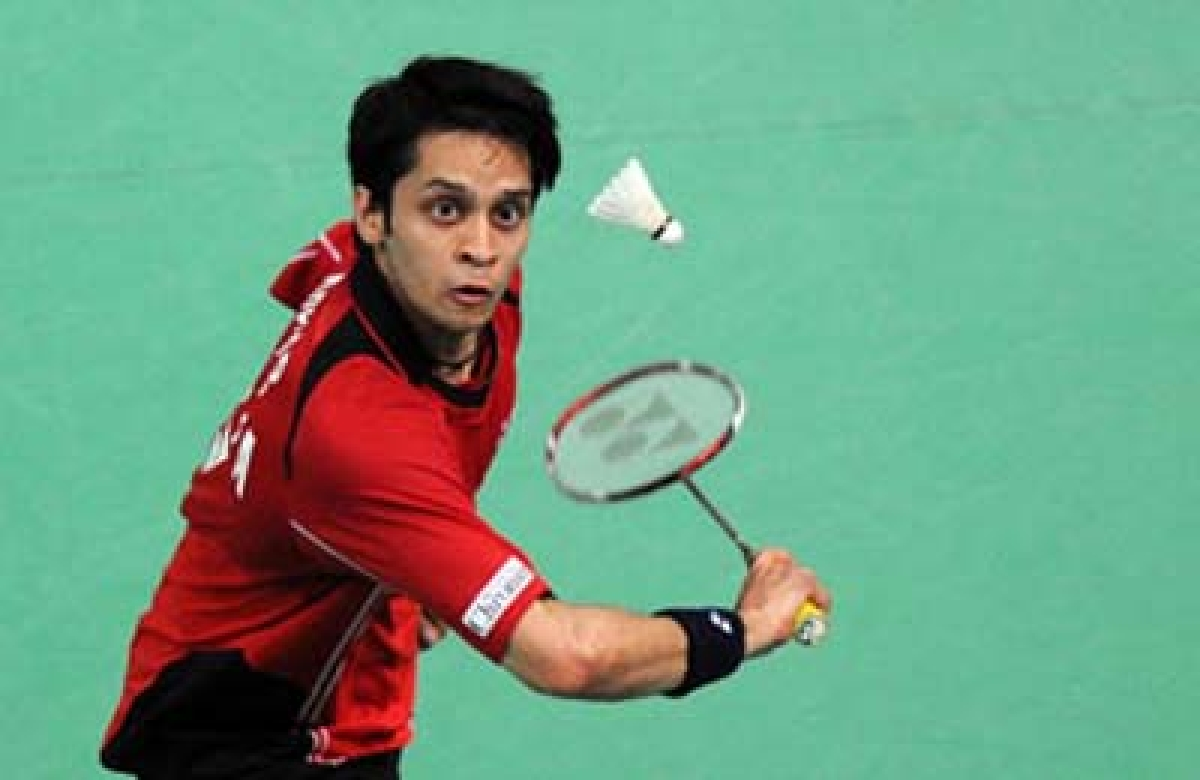 India's Kashyap Parupalli  returns a shot against Indonesia's Taufik Hidayat during the Thomas Cup badminton championships in Kuala Lumpur on May 12,2010. AFP PHOTO/Saeed KHAN (Photo credit should read SAEED KHAN/AFP/Getty Images)