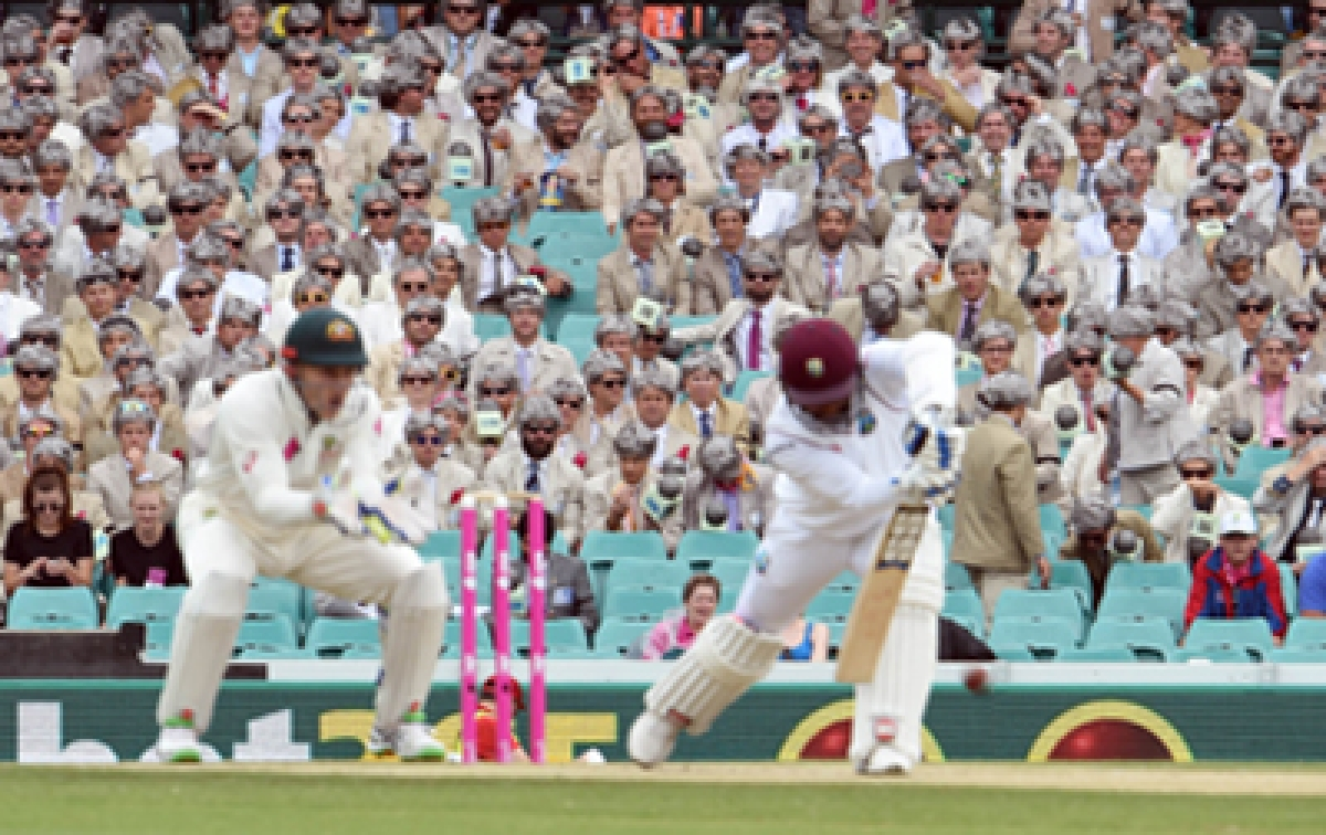 Hundred of spectators dressed as the late cricket commentator Richie Benaud watch Australia and the West Indies battle it out on the second day of the third cricket Test match in Sydney on January 4, 2016.   AFP PHOTO / William WEST    --IMAGE RESTRICTED TO EDITORIAL USE - NO COMMERCIAL USE--