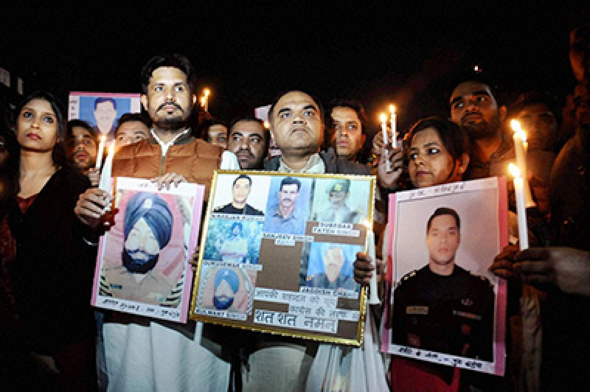 New Delhi: Youth Congress National President Amarinder Singh Raja along with supporters take part in a candle light march to pay tribute to the martyrs of Pathankot attack, at Jantar Mantar in New Delhi on Monday. PTI Photo (PTI1_4_2016_000313B)
