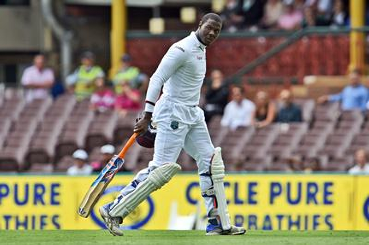 West Indies batsman Carlos Brathwaite walks off after been dismissed by Australian paceman James Pattinson on the second day of the third cricket Test match in Sydney on January 4, 2016.   AFP PHOTO / William WEST    --IMAGE RESTRICTED TO EDITORIAL USE - NO COMMERCIAL USE--