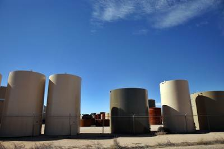 ANDREWS, TX - JANUARY 20: Unused tanks for the oil industry pile-up in a shop yard in the Permian Basin oil field on January 20, 2016 in the oil town of Andrews, Texas. Despite recent drops in the price of oil, many residents of Andrews, and similar towns across the Permian, are trying to take the long view and stay optimistic. The Dow Jones industrial average plunged 540 points on Wednesday after crude oil plummeted another 7% and crashed below $27 a barrel.   Spencer Platt/Getty Images/AFP == FOR NEWSPAPERS, INTERNET, TELCOS & TELEVISION USE ONLY ==