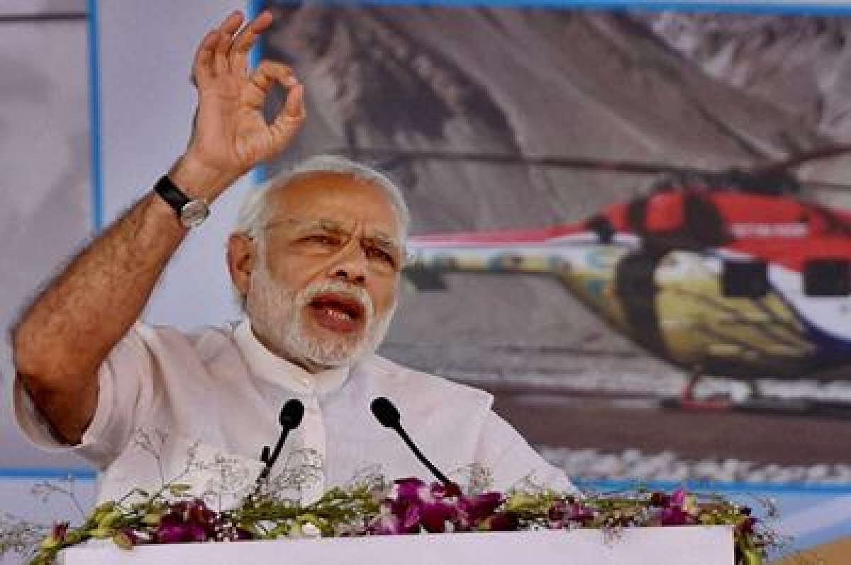 Bengaluru: Prime Minister Narendra Modi speaks during the laying the foundation stone for HAL's new helicopter manufacturing facility at Biderehalla Kaval,Gubbi taluk, near Bengaluru on Sunday.PTI Photo by Shailendra Bhojak(PTI1_3_2016_000123B)