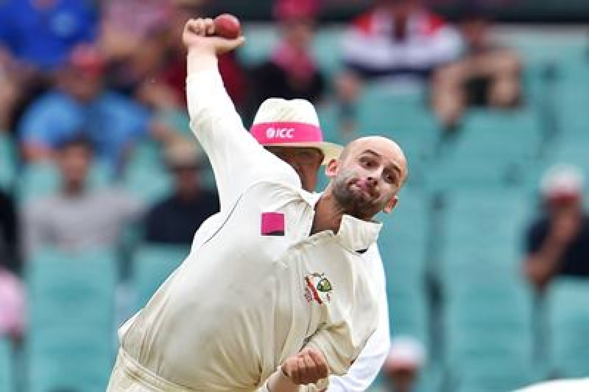 Australian spinner Nathan Lyon sends down a delivery to the West Indies batsman on the first day of the third cricket Test match in Sydney on January 3, 2016.   AFP PHOTO / William WEST   --IMAGE RESTRICTED TO EDITORIAL USE - NO COMMERCIAL USE--
