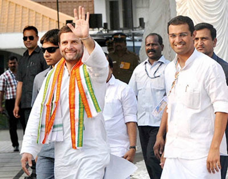 Angamali: Congress Vice President Rahul Gandhi with NSUI president Roji M. John  during the program of NSUI National Executive meeting  at Angamali in Kochi on Wednesday. PTI Photo (PTI2_10_2016_000282B)