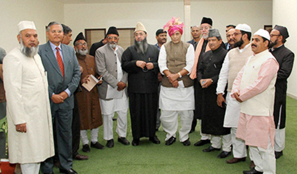 New Delhi: Union Home Minister Rajnath Singh poses with the Muslim community clerics and leaders in New Delhi on Tuesday. PTI Photo   (PTI2_2_2016_000127B)