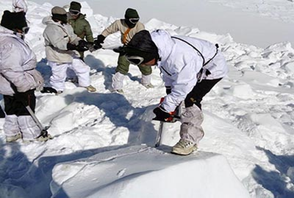 """In this handout photograph released by the Indian Defence Ministry on February 8, 2016, an Indian army soldier cuts through ice and snow in the search for survivors after a deadly avalanche on the Siachen glacier. An Indian soldier rescued nearly a week after he was buried by a deadly avalanche on the world's highest battleground was Tuesday airlifted to Delhi in critical but stable condition, the army said. General D. S. Hooda, who heads the Indian Army's northern command, called it a """"miracle"""" as he described the huge challenges faced by the rescue team, operating at an altitude of 5,900 metres (19,600 feet).   AFP PHOTO/Indian Defence Ministry -----EDITORS NOTE --- RESTRICTED TO EDITORIAL USE - MANDATORY CREDIT - """"AFP PHOTO / Indian Defence Ministry """" - NO MARKETING NO ADVERTISING CAMPAIGNS - DISTRIBUTED AS A SERVICE TO CLIENTS------"""
