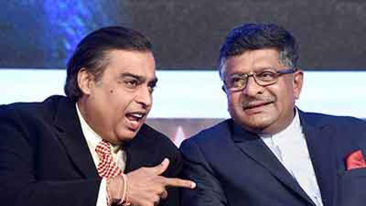 Union Minister of Communications & Information Tecnology Ravi Shankar Prasad with Reliance Industries Chairman Mukesh Ambani