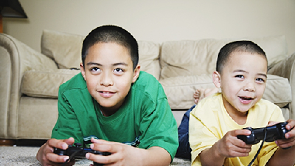 Boys playing video game