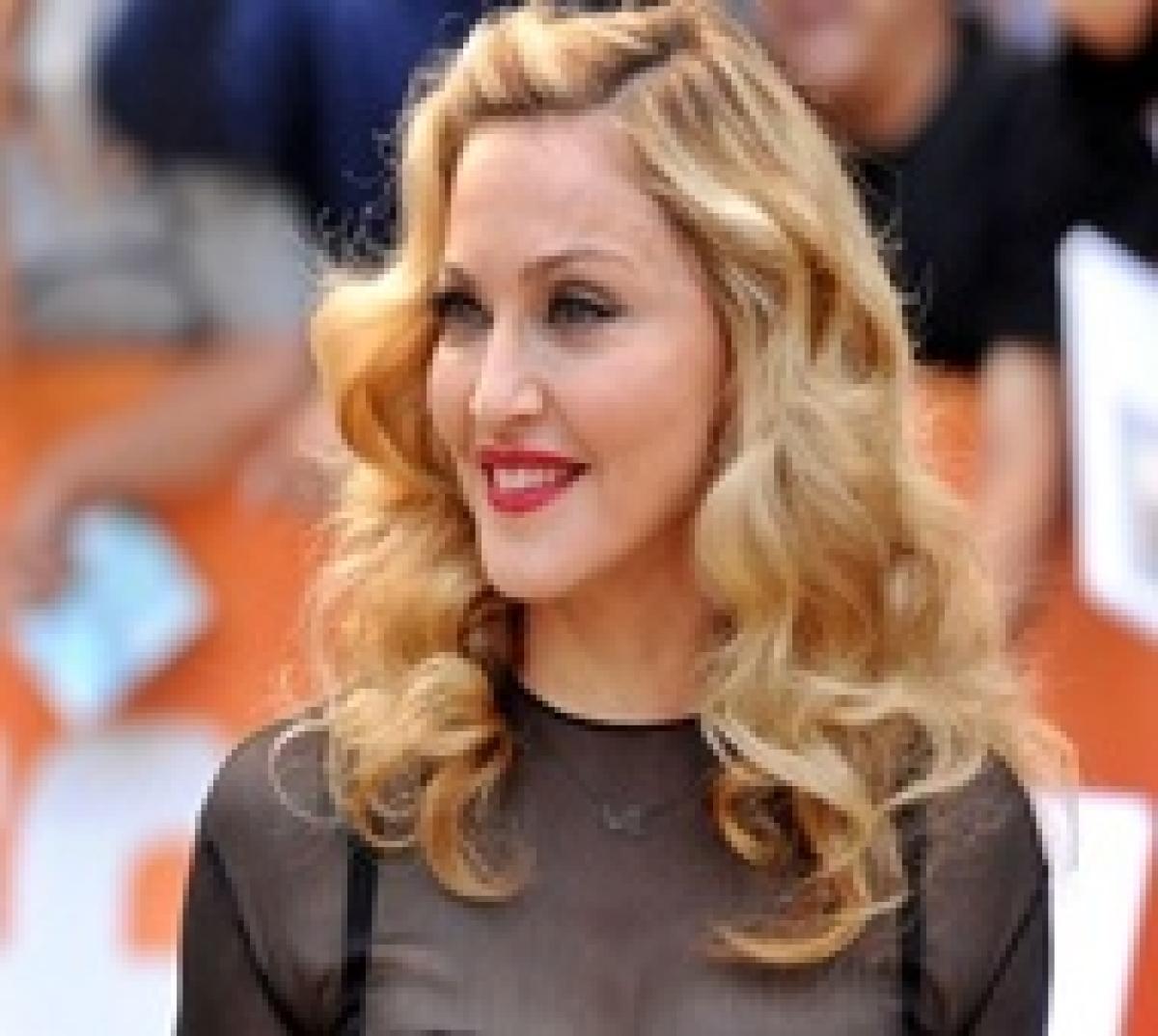 Madonna beaks down on stage