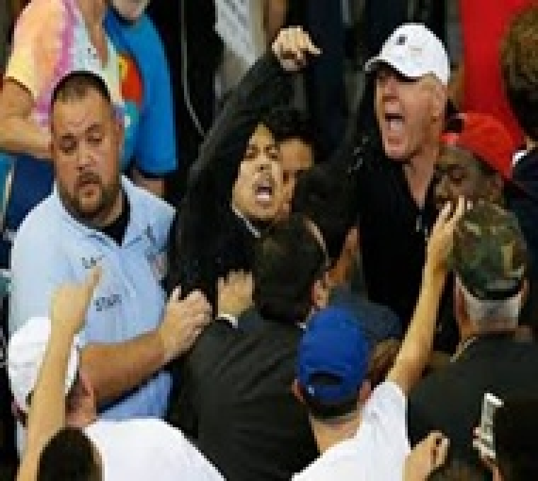 Elderly US man punches protester at Trump rally