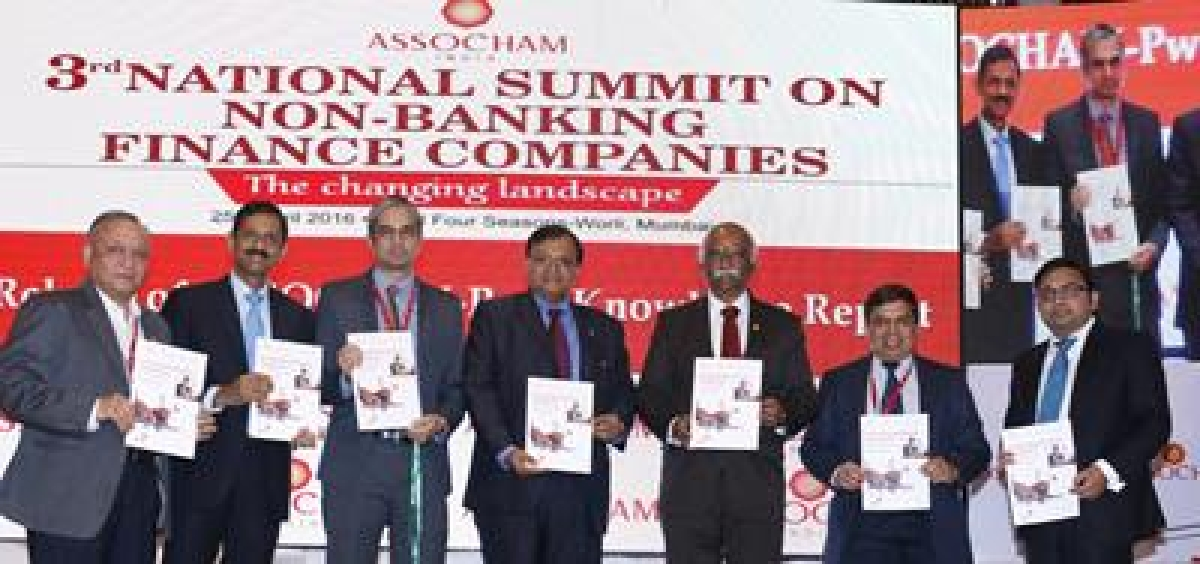 (L-R) RBI deputy governor, Mr R. Gandhi releasing summit backgrounder along with Assocham president, Mr Sunil Kanoria and other luminaries at an Assocham National Seminar on NBFCs: The Changing Landscape, in Mumbai