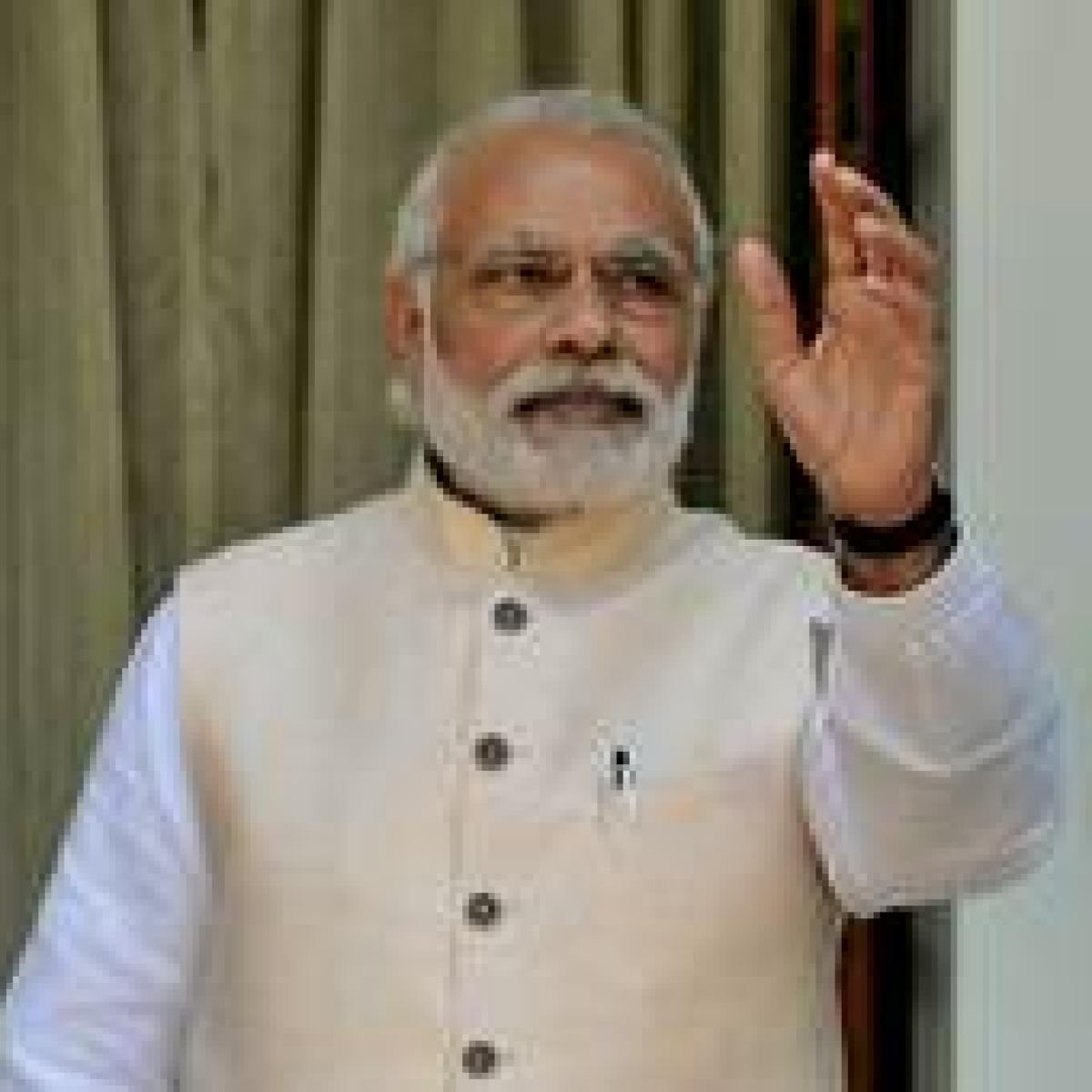 Modi meets 'friend' Jaitley's family on return home