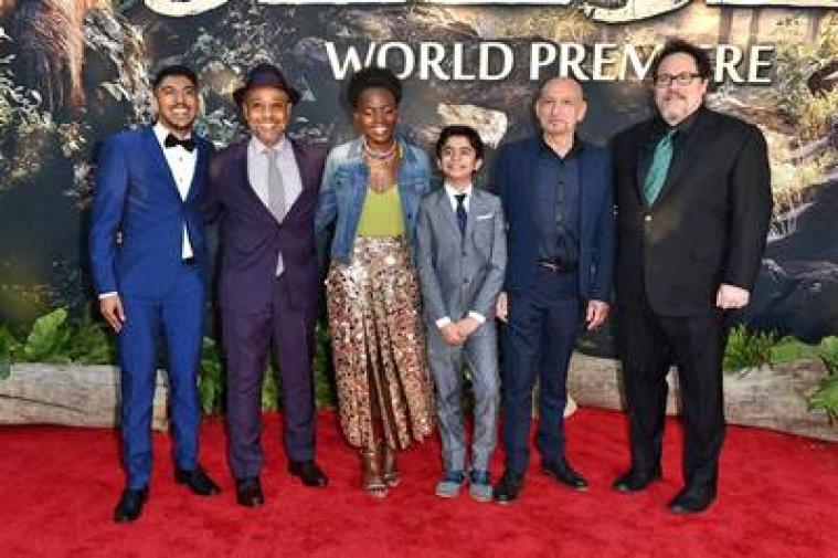 "Los Angeles : Ritesh Rajan, from left, Giancarlo Esposito, Lupita Nyong'o, Neel Sethi and Ben Kingsley and Jon Favreau arrive at the premiere of ""The Jungle Book"" at the El Capitan Theatre on Monday, April 4, 2016, in Los Angeles.  AP/PTI(AP4_5_2016_000112B)"