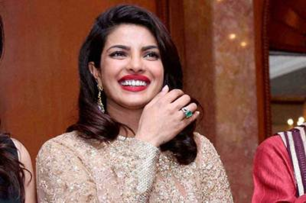 New Delhi: Rajya Sabha Member T Subbarami Reddy speaks at a get-together function organised by him to felicitate actress Priyanka Chopra (L) on being honored with Padma Shri Award, in New Delhi on Tuesday. British High Commissioner to India Dominic Asquith (R) and fashion designer Ritu Beri are also seen. PTI Photo  (PTI4_13_2016_000140B)