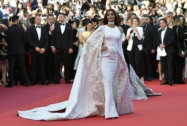 "Indian actress Sonam Kapoor poses as she arrives on May 15, 2016 for the screening of the film ""Mal de Pierres (From the Land of the Moon)"" at the 69th Cannes Film Festival in Cannes, southern France."