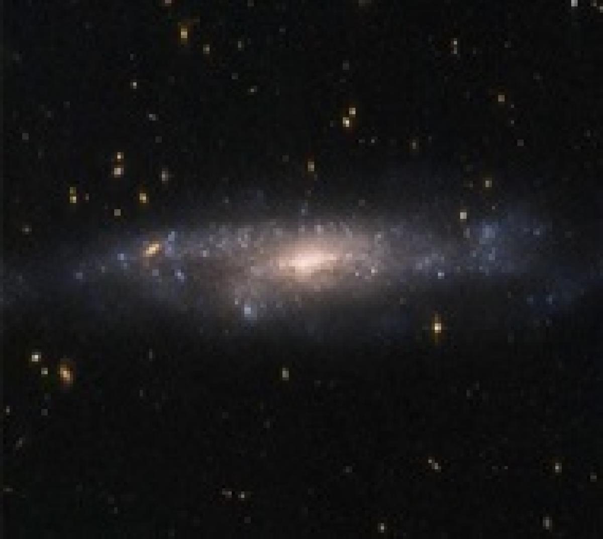 Hubble spots rare hidden galaxy in night sky