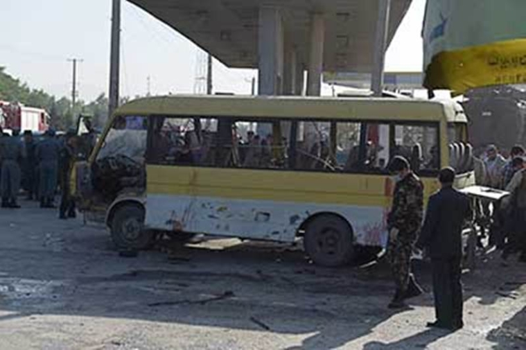 "TOPSHOT - Afghan policemen look at the site of a suicide attack to have hit a minibus carrying foreign security guards in Kabul on June 20, 2016. A suicide bomber hit a minibus carrying foreign security guards and caused several casualties early on June 20 in Kabul along the main road to the eastern city of Jalalabad, police said. The attacker was on foot, according to police, who refused to give a toll but said there were ""multiple casualties"" among the bus passengers who were ""employees of a foreign compound"".The bus was carrying Nepalese guards, according to an AFP cameraman, who also reported more than two dozen ambulances at the scene.   / AFP PHOTO / SHAH MARAI"