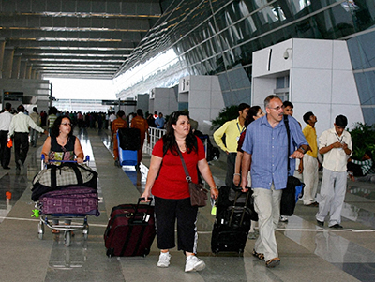 New Delhi: International passengers at the newly opened Terminal 3 of the Indira Gandhi International Airport in New Delhi on Wednesday.  The new structure is spread over more than 120 acres (50 hectares) and with more than 160 check-in windows it can handle 34 million passengers a year, according to Delhi International Airport (P) LTD, the consortium that built and operates the airport terminal.     PTI Photo by Kamal Kishore(PTI7_28_2010_000211B)