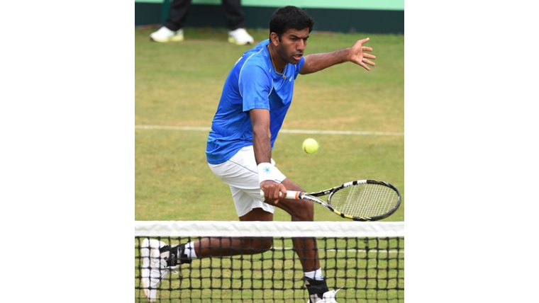 India's Rohan Bopanna plays a return during his singles match against South Korea's Hong Chung at the Davis Cup