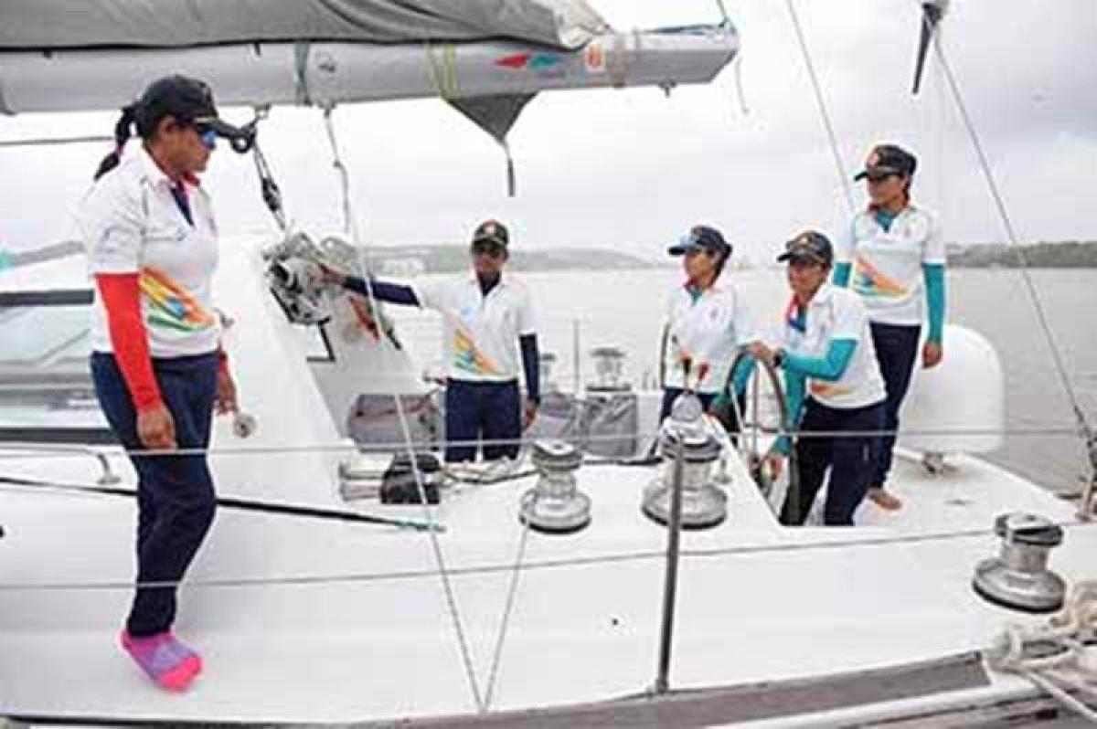 Goa: Indian navy's women team led by  Lt. Cdr. Vartika Joshi and crew Lt. B. Aishwarya, Lt. P Swati, Lt. Prathiba Jamwal, Lt. Vijaya and Slt. Payal Gupta on their return to Goa on Thursday after their voyage to Mauritious. PTI Photo  (PTI7_14_2016_000271B)