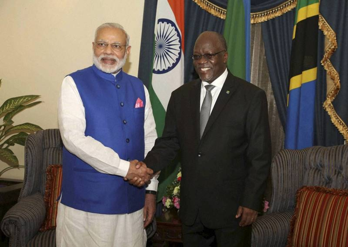 Dar es Salaam: Prime Minister Narendra Modi, left, poses with Tanzania President John Pombe Magufuli for a photo at State House in Dar es Salaam, Tanzania  Sunday.PTI Photo(PTI7_10_2016_000046B)