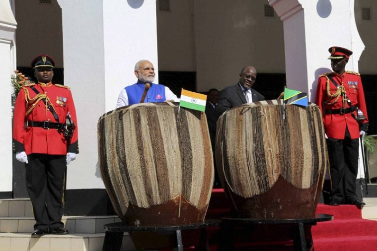 Dar es Salaam:  Prime Minister Narendra Modi, left, and his host Tanzanian President John Pombe Magufuli, right, beat drums at the entrance of State House during an official welcome ceremony for Modi in Dar es Salaam Tanzania Sunday.PTI Photo(PTI7_10_2016_000048B)