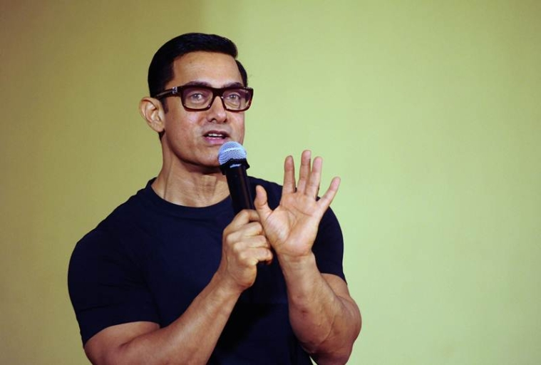 "Indian Bollywood actor Aamir Khan attends the poster launch of his upcoming biographical sports drama ""Dangal"" in Mumbai on July 4, 2016. / AFP PHOTO / -"
