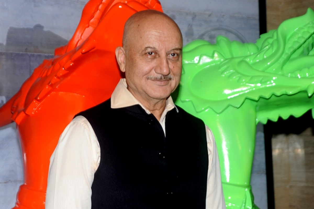 Indian Bollywood actor Anupam Kher attends a party for a newly-opened restaurant in Mumbai on July 2, 2016. / AFP PHOTO / -