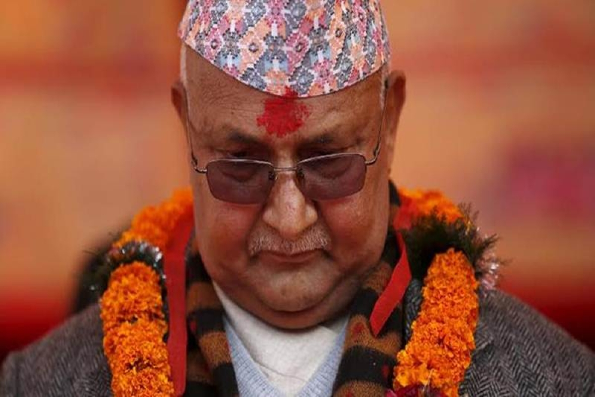Nepal's Prime Minister Khadga Prasad Sharma Oli, also known as KP Oli, observes a minute of silence for earthquake victims during an event organised to mark the 18th National Earthquake Safety Day and the official launch of earthquake reconstruction efforts in Bungamati village, Nepal January 16, 2016. REUTERS/Navesh Chitrakar
