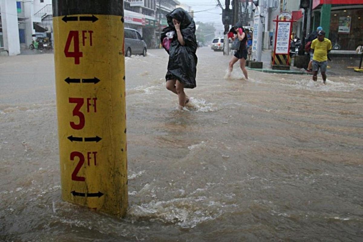 China warns of typhoon, floods