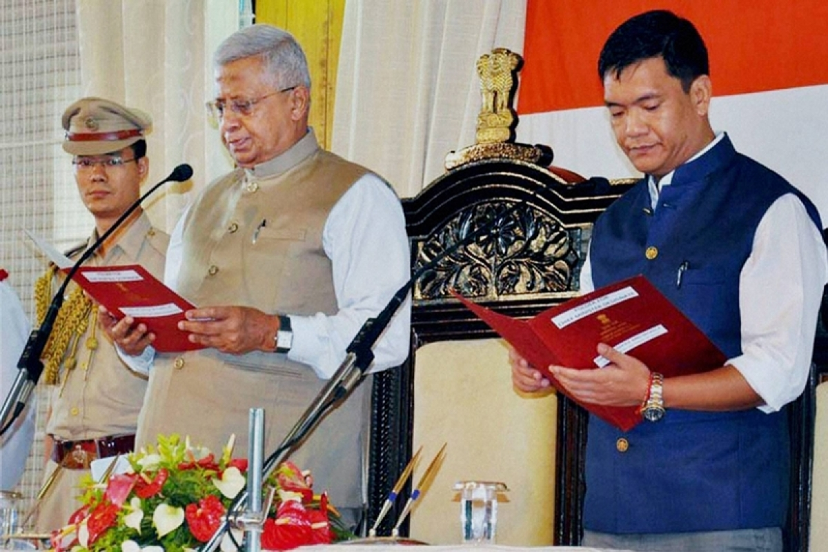 Itanagar: Congress leader Pema Khandu is sworn-in as the ninth Chief Minister of Arunachal Pradesh by Governor Tathagata Roy at a ceremony in Itanagar on Sunday. PTI Photo  (PTI7_17_2016_000107B)