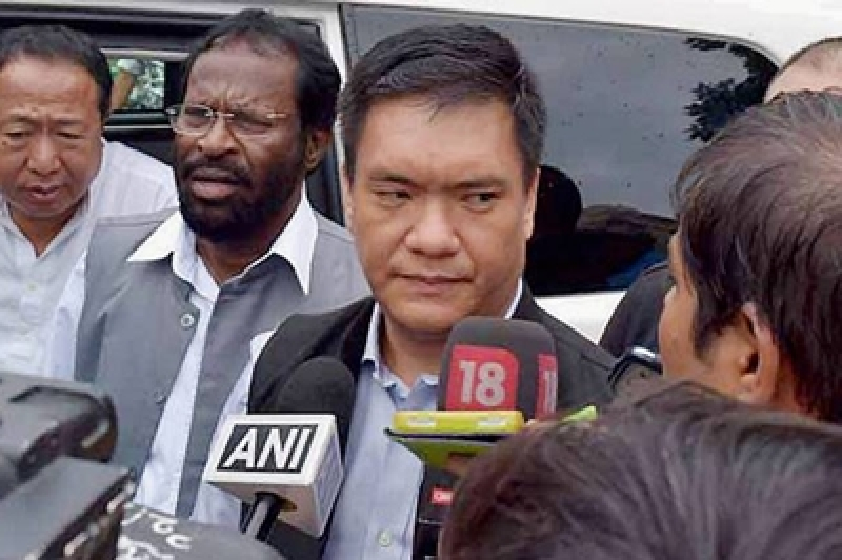 Itanagar: Designated Arunachal Pradesh Chief Minister Pema Khandu talking to reporters at Raj Bhawan after staking claim to form the Congress government in the state in Itanagar on Saturday. PTI Photo (PTI7_16_2016_000169a)