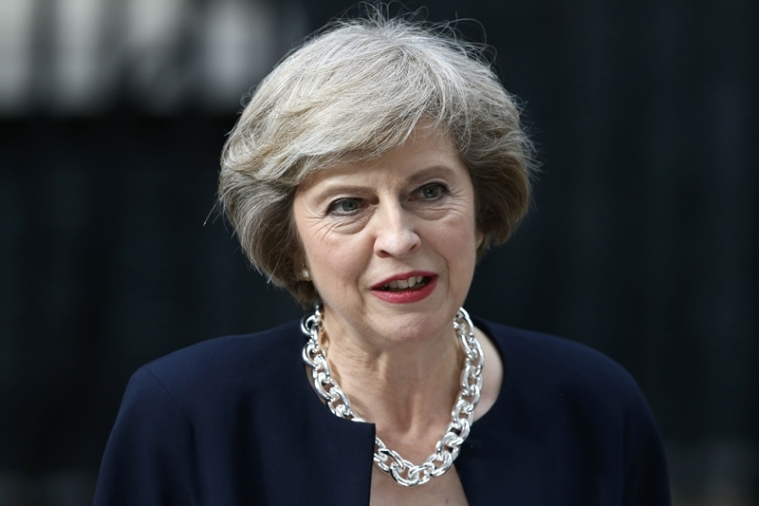 Britain's new Prime Minister Theresa May speaks outside 10 Downing Street in central London on July 13, 2016 on the day she takes office following the formal resignation of David Cameron.  Theresa May took office as Britain's second female prime minister on July 13 charged with guiding the UK out of the European Union after a deeply devisive referendum campaign ended with Britain voting to leave and David Cameron resigning.   / AFP PHOTO / JUSTIN TALLIS