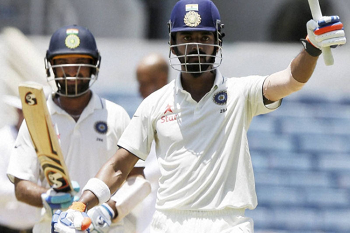 Kingston : India's Lokesh Rahul celebrates after he scored a century during his partnership with India's Cheteshwar Pujara, back left, during day two of their second cricket Test match against West Indies at the Sabina Park Cricket Ground in Kingston, Jamaica, Sunday, July 31, 2016. AP/PTI(AP7_31_2016_000207B)