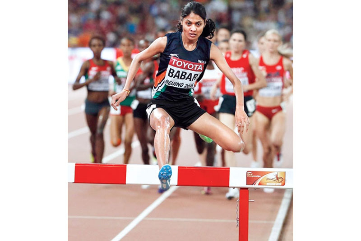 """India's Lalita Shivaji Babar competes in the final of the women's 3000 metres steeplechase athletics event at the 2015 IAAF World Championships at the """"Bird's Nest"""" National Stadium in Beijing on August 26, 2015. AFP PHOTO / ADRIAN DENNIS"""