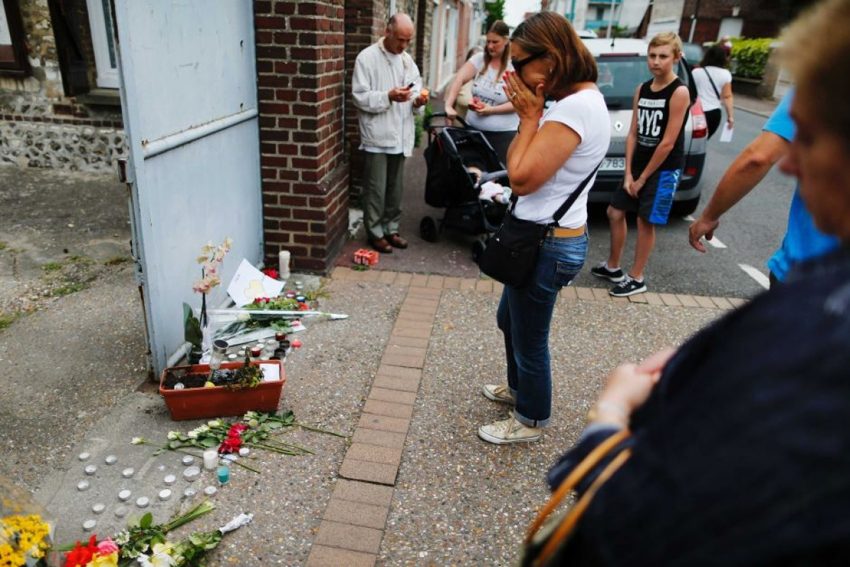 Another youth held for French priest's murder
