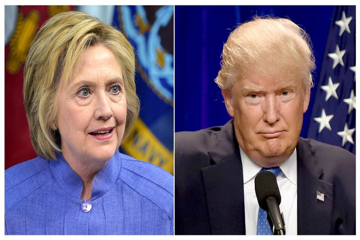 """(FILES) This combination of file photos shows Democratic presidential candidate Hillary Clinton(L)on June 15, 2016 and presumptive Republican presidential nominee Donald Trump on June 13, 2016.  Hillary Clinton on July 31, 2016 sharply criticized Donald Trump over his """"absolute allegiance"""" to Russian policy aims, saying it raised both """"national security issues"""" and new doubts about his temperament. / AFP PHOTO / dsk"""