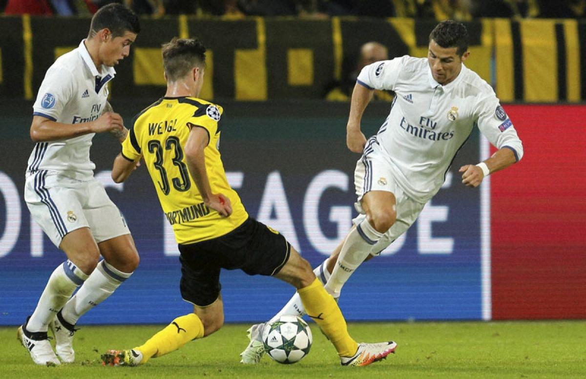 Real held by Borussia Dortmund; Tottenham Hotspur, Juventus win